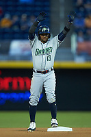Andres Blanco (13) of the Gwinnett Braves stands on second base after hitting a double against the Durham Bulls at Durham Bulls Athletic Park on April 20, 2019 in Durham, North Carolina. The Bulls defeated the Braves 3-2 in game two of a double-header. (Brian Westerholt/Four Seam Images)