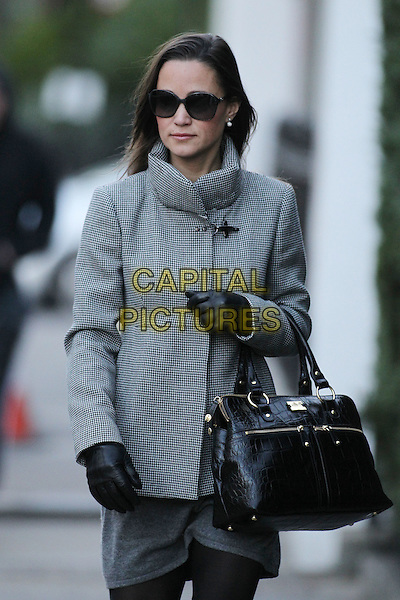 Pippa Middleton arrives for work, London, England..December 7th, 2011.half length grey gray coat sunglasses shades black bag purse gloves.CAP/HIL.©John Hillcoat/Capital Pictures .