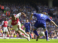 Premiership Football - Arsenal v Leicester City:.2003/04 Season - 15/05/2004  [Record breaking Season undefeated] .Thierry Henry, tries to run the ball through Lilian Nalis legs.[Credit] Peter Spurrier Intersport Images