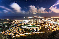 "An aerial view of Kaneohe at night from Haiku Stairs (""Stairway to Heaven"") hiking trail in Kaneohe, Oahu"