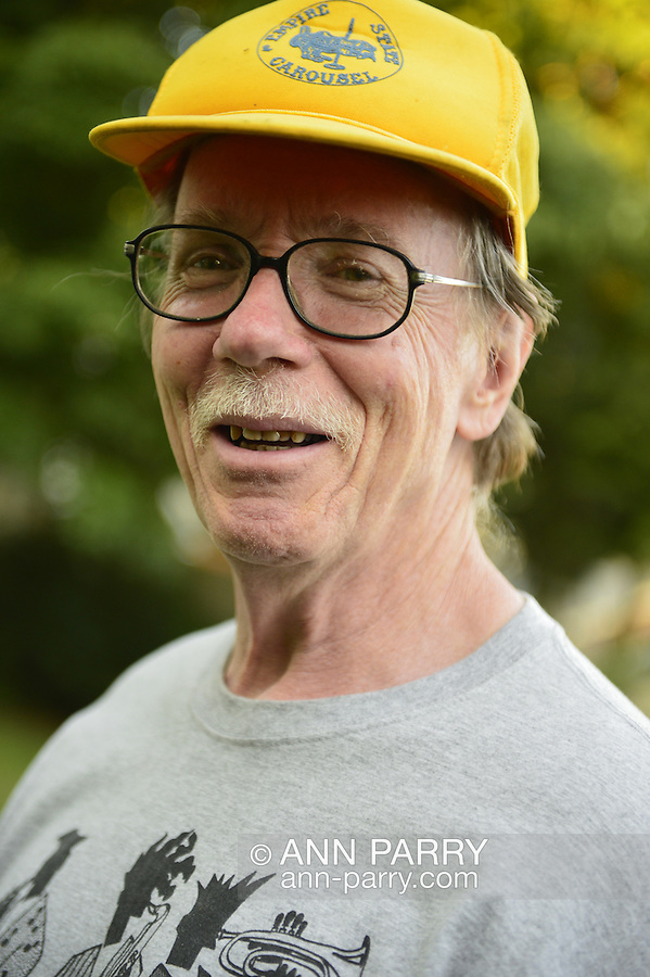Garden City Park, New York, U.S. - July 5, 2014 - Bob Stuhmer in backyard during Independence Day holiday weekend, on Long Island.