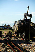 Delapidated old wooden boat on the shingle beach of Dungeness, Kent