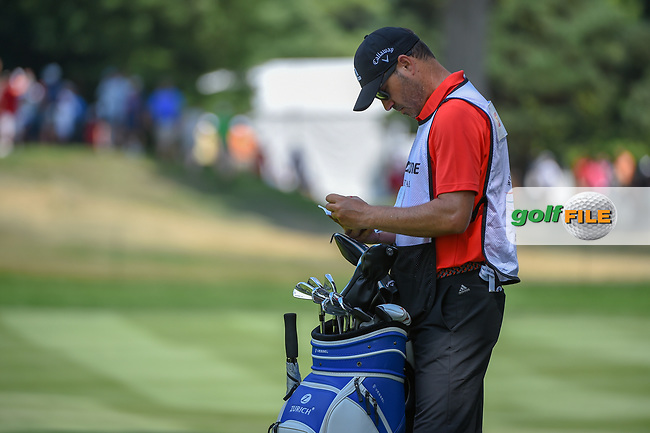 Sergio Garcia's (ESP) caddie/brother, Victor, looks over the yardage for Sergio's approach shot on 2 during 4th round of the World Golf Championships - Bridgestone Invitational, at the Firestone Country Club, Akron, Ohio. 8/5/2018.<br /> Picture: Golffile | Ken Murray<br /> <br /> <br /> All photo usage must carry mandatory copyright credit (© Golffile | Ken Murray)