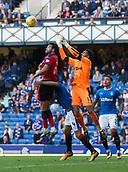 9th September 2017, Ibrox Park, Glasgow, Scotland; Scottish Premier League football, Rangers versus Dundee; Rangers' goalkeeper Wes Foderingham competes in the air with Dundee's Sofien Moussa