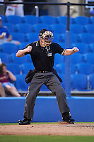 Umpire Richard Riley strike three call during the second game of a doubleheader between the Palm Beach Cardinals and Dunedin Blue Jays on July 31, 2015 at Florida Auto Exchange Stadium in Dunedin, Florida.  Dunedin defeated Palm Beach 4-0.  (Mike Janes/Four Seam Images)