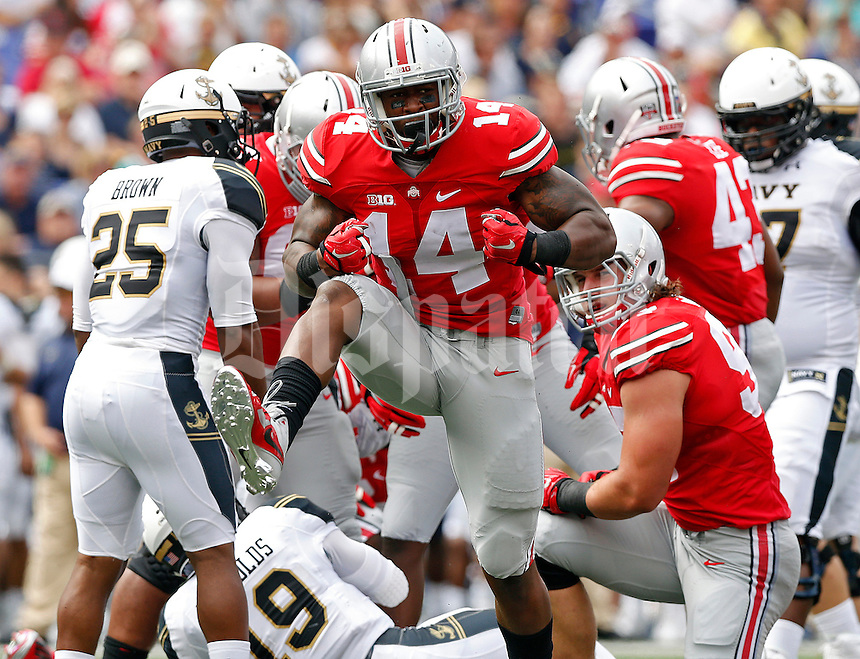 Ohio State Buckeyes linebacker Curtis Grant (14) celebrates after a tackle of Navy Midshipmen quarterback Keenan Reynolds (19) in the 1st quarter of their NCAA game at M&T Bank Stadium in Baltimore, Maryland on August 30, 2014. (Dispatch photo by Kyle Robertson)