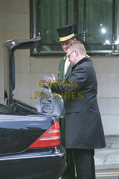 MORRISSEY - THE SMITHS.Dorchester Hotel.June 27th, 2004.paparazzi pictures, half length, chauffeur, car, trunk, boot, bag, sainsbury's, uniform.www.capitalpictures.com.sales@capitalpictures.com.©Capital Pictures