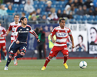 FC Dallas midfielder David Ferreira (10) dribbles at midfield as New England Revolution midfielder Lee Nguyen (24) closes..  In a Major League Soccer (MLS) match, FC Dallas (red) defeated the New England Revolution (blue), 1-0, at Gillette Stadium on March 30, 2013.