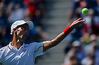 Novak Djokovic of Serbia serves to Kei Nishikori of Japan during men semifinal match at the US Open 2014 tennis tournament in the USTA Billie Jean King National Center, New York.  09.05.2014. VIEWpress