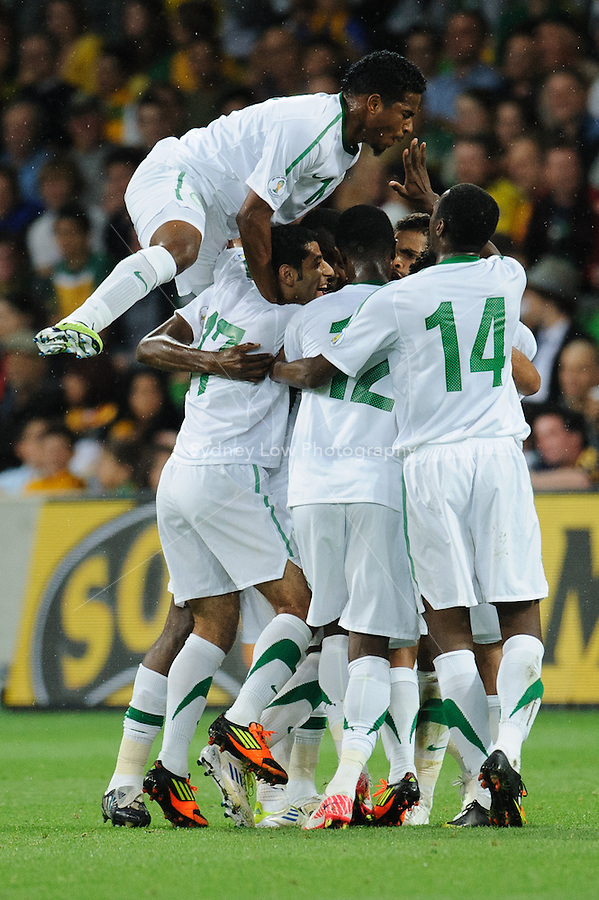 Saudi Arabian team mates celebrate a goal during the FIFA 2014 World Cup Group D Asian Qualifier match between Australia and Saudi Arabia at AAMI Park in Melbourne, Australia...This image is not for sale on this web site. Please contact Southcreek Global Media for licensing:.Toll Free: 1.800.934.5030.Canada: 701 Rossland Rd. East, Suite 315, Whitby, Ontario, Canada, L1N 9K3.USA: 10792 Baron Dr, Parma OH, USA 44130.Web: http://southcreekglobal.net/ and http://southcreekglobal.com/