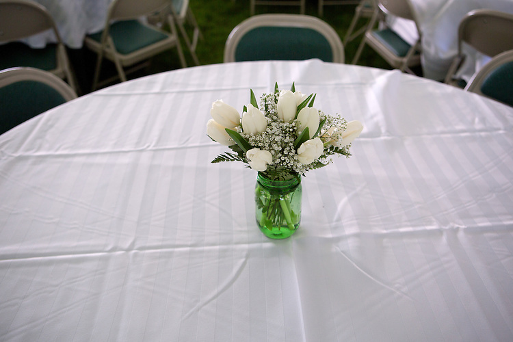 "Bouquets of tulips decorate tables during a barbecue for Ohio Univeristy alumni and their families on the College Green on May 31, 2014. The event was part of the ""On The Green"" weekend, hosted by the Ohio University Alumni Association. Photo by Lauren Pond"