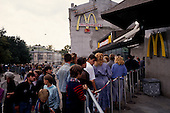 "Moscow, Russia<br /> Soviet Union<br /> August 30, 1991<br /> <br /> People line up to enter one of the first McDonalds, an American fast food chain restaurant, in Russia at Groky Street.<br /> <br /> In December 1991, food shortages in central Russia had prompted food rationing in the Moscow area for the first time since World War II. Amid steady collapse, Soviet President Gorbachev and his government continued to oppose rapid market reforms like Yavlinsky's ""500 Days"" program. To break Gorbachev's opposition, Yeltsin decided to disband the USSR in accordance with the Treaty of the Union of 1922 and thereby remove Gorbachev and the Soviet government from power. The step was also enthusiastically supported by the governments of Ukraine and Belarus, which were parties of the Treaty of 1922 along with Russia.<br /> <br /> On December 21, 1991, representatives of all member republics except Georgia signed the Alma-Ata Protocol, in which they confirmed the dissolution of the Union. That same day, all former-Soviet republics agreed to join the CIS, with the exception of the three Baltic States."