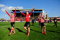 Lincoln City players, from left, Tom Pett, Shay McCartan and Harry Anderson, celebrate after securing promotion from Sky Bet League Two<br /> <br /> Photographer Chris Vaughan/CameraSport<br /> <br /> The EFL Sky Bet League Two - Lincoln City v Cheltenham Town - Saturday 13th April 2019 - Sincil Bank - Lincoln<br /> <br /> World Copyright &copy; 2019 CameraSport. All rights reserved. 43 Linden Ave. Countesthorpe. Leicester. England. LE8 5PG - Tel: +44 (0) 116 277 4147 - admin@camerasport.com - www.camerasport.com