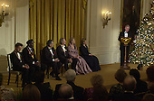 United States President Bill Clinton makes remarks at the White House reception for the recipients of the 2000 Kennedy Center Honors in the East Room of the White House in Washington, D.C. on Sunday, December 3, 2000. From left to right: honorees Mikhail Baryshnikov, Chuck Berry, Placido Domingo, Clint Eastwood, Angela Lansbury and first lady Hillary Rodham Clinton..Credit: Ron Sachs / Pool via CNP