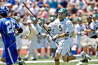 April 30, 2011:  Jacksonville Dolphins defender Tanner Gard (9) during lacrosse action between the Duke Blue Devils and Jacksonville Dolphins at D. B. Milne Field in Jacksonville, Florida.  Duke defeated Jacksonville 10-6.