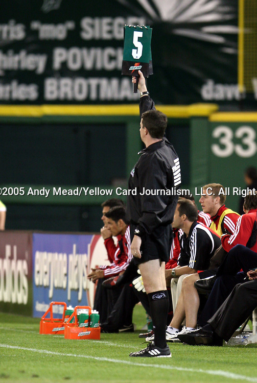 21 May 2005: Fourth Official Ben Jones indicates five minutes of stoppage time to be added to the second half. DC United defeated the Kansas City Wizards 3-2 at RFK Stadium in Washington, DC in a regular season Major League Soccer game. . .