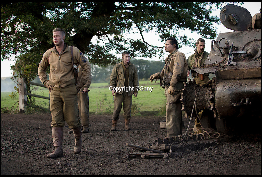 BNPS.co.uk (01202 558833)<br /> Pic: Sony/BNPS<br /> <br /> ***Please Use Full Byline***<br /> <br /> A still taken from the film Fury of Wardaddy (Brad Pitt) and his crew, Norman Ellison(Logan Lerman), Trini Garcia (Michael PeÒa) and Boyd Swan (Shia LaBeouf).<br /> <br /> Meet the real driving force behind Brad Pitt's new Second World War blockbuster, Fury.<br /> <br /> Tank mechanics Brian Frost, 39, and Ian 'Buzz' Aldridge, 53, were hired to drive the famous Sherman tank the movie is named after for most of the major scenes.<br /> <br /> The pair, who work at Bovington Tank Museum in Dorset, spent six months taking it in turns to operate the 26 ton tank in front of the cameras.<br /> <br /> Although the two never appear in the movie, every time 'Fury' is seen in motion and without actor Michael Pena in the driving seat,<br /> Brian or Buzz are at the controls.<br /> <br /> The pair also trained actor Pena the basics of driving the Sherrman tank to give the close-up shots of his character Corporal Trini 'Gordo' Garcia more legitimacy.<br /> <br /> The museum lent the movie's producers their M4 Sherman tank to act as Fury as well as the services of Brian and Buzz.