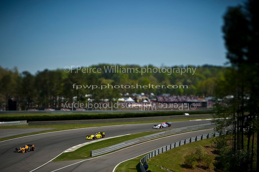 Simona deSilvesto (#78), Graham Rahal (#67) and Hideki Mutoh (#06) rolls through turn one at Barber Motorsports Park...(NOTE: Image capture with a tilt/shift lens)