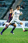 Auckland City Midfielder Albert Riera (r) is chased by Joao Pereira of SC Kitchee (l) during the Nike Lunar New Year Cup 2017 match between SC Kitchee (HKG) and Auckland City FC (NZL) on January 31, 2017 in Hong Kong, Hong Kong. Photo by Marcio Rodrigo Machado / Power Sport Images