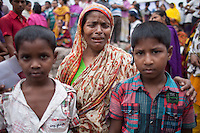 Relatives of victims killed in the collapse of Rana Plaza mourn on the second year anniversary in Savar, near Dhaka, Bangladesh