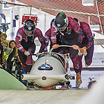 9 January 2016: Canadian pilot Chris Spring leads his 4-man team as they push off their first run of the day at the BMW IBSF World Cup Bobsled Championships at the Olympic Sports Track in Lake Placid, New York, USA. Spring's team came in 12th for the day, with a 2-run combined time of 1:51.20. Mandatory Credit: Ed Wolfstein Photo *** RAW (NEF) Image File Available ***