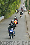 Bikers drive through Currow village at the start of the Duagh Bikers Poker Run in Currow last Saturday..