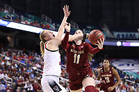 GREENSBORO, NC - MARCH 07: Emma Guy #11 of Boston College is fouled by Elissa Cunane #33 of North Carolina State University during a game between Boston College and NC State at Greensboro Coliseum on March 07, 2020 in Greensboro, North Carolina.