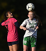 Emma Best #19 of Farmingdale, right, heads a ball away from Nicolette Manzella #7 of Baldwin during a Nassau County Conference AA-1 varsity girls soccer game at Baldwin High School on Wednesday, Oct. 17, 2018. Best scored a goal midway through the first half to even the match 1-1. Farmingdale went on to win by a score of 3-1.