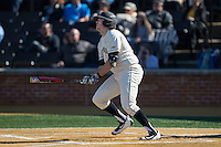 Will Craig (22) of the Wake Forest Demon Deacons watches the flight of the first of two home runs on the fay against the Richmond Spiders at David F. Couch Ballpark on March 6, 2016 in Winston-Salem, North Carolina.  The Demon Deacons defeated the Spiders 17-4.  (Brian Westerholt/Four Seam Images)