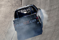 May 30, 2008; Dover, DE, USA; Smoke pours from the vehicle of Nascar Craftsman Truck Series driver Kyle Busch after he blew a transmission while leading during the AAA Insurance 200 at Dover International Speedway. Mandatory Credit: Mark J. Rebilas-US PRESSWIRE.