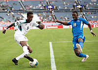DENVER, CO - JUNE 19: Samuel Camille #18 defends against Maykel Reyes #9 during a game between Martinique and Cuba at Broncos Stadium on June 19, 2019 in Denver, Colorado.