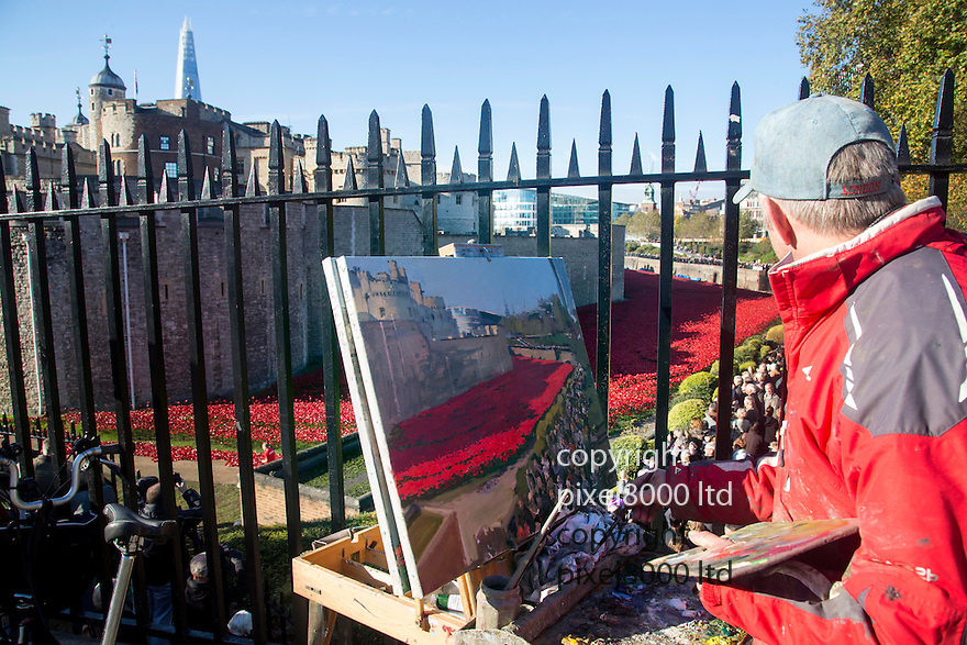 Pic shows: Huge crowds again today at the Blood Swept Lands and Seas of Red<br /> Poppy installation at the Tower of London with just days to  go before it is due to be removed.<br /> <br /> painter at work to capture the event<br /> <br /> <br /> <br /> Pic by Gavin Rodgers/Pixel 8000 Ltd