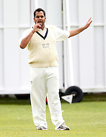Hornsey captain Chetan Patel directs his team during the Middlesex County League Division two game between North Middlesex and Hornsey at Park Road, Crouch End on Sat July 9, 2011