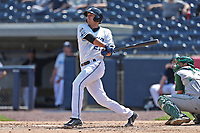West Michigan Michigan Whitecaps shortstop Daniel Pinero (21) follows through on his swing against the Fort Wayne TinCaps during the Midwest League baseball game on April 26, 2017 at Fifth Third Ballpark in Comstock Park, Michigan. West Michigan defeated Fort Wayne 8-2. (Andrew Woolley/Four Seam Images)