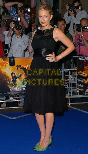 "ALICE EVANS.At the UK Film Premiere of ""Fantastic Four"",.Vue Cinema, Leicester Square, .London, July 18th 2005..full length black dress green shoes stilettoes hands on hips.Ref: CAN.www.capitalpictures.com.sales@capitalpictures.com.©Can Nguyen/Capital Pictures."