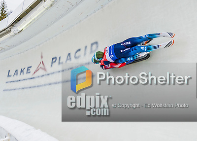 5 December 2014:  Vladislav Yuzhakov and Vladimir Prokhorov, sliding for Russia, bank into Curve 10 on their second run, ending the day with a 5th place finish and a combined 2-run time of 1:28.229 in the Men's Doubles Competition at the Viessmann Luge World Cup, at the Olympic Sports Track in Lake Placid, New York, USA. Mandatory Credit: Ed Wolfstein Photo *** RAW (NEF) Image File Available ***