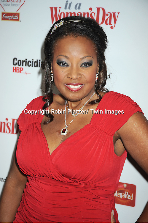 Star Jones in Calvin Klein red dress attends Woman's Day Red Dress Awards on February 15, 2012 at Jazz at Lincoln Center in New York City. Dr Oz, Star Jones and US Surgeon General Dr Regina Benjamin were honored.