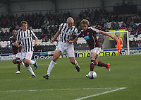 Arvydas Novikovas holds off Jim Goodwin as Paul McGowan watches on in the St Mirren v Heart of Midlothian Clydesdale Bank Scottish Premier League match played at St Mirren Park, Paisley on 15.9.12.