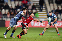 25th July 2020, Christchurch, New Zealand;  Richie Mo'unga of the Crusaders eludes Ardie Savea of the Hurricanes during the Super Rugby Aotearoa, Crusaders versus Hurricanes at Orangetheory stadium, Christchurch