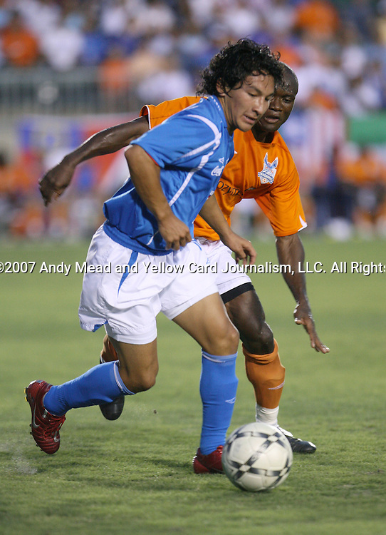Cruz Azul's Cesar Villaluz (MEX) is chased by Carolina's Philip Kutsu (behind). The United Soccer League Division 1 Carolina Railhawks played Club Deportivo Cruz Azul of La Primera Division del Futbol Mexicano on Wednesday, July 25, 2007 in an international club friendly game at SAS Stadium in Cary, North Carolina/