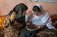 Women embroidering at the Education Center for Women Widows.