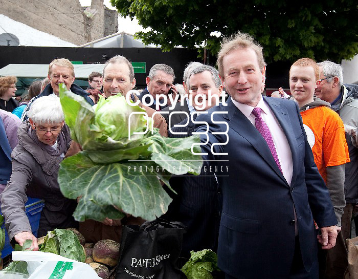 Taoiseach Enda Kenny T.D shows  the  head of Cabbage he got from a Vender  in the Milk Market in  Limerick while canvassing for the yes Vote Pictured Credit Brian Gavin Press 22