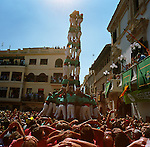 To the far western part of Spain in Catalonia is the tiny village of Vilafranca del Penedes.  It is home to an annual castellers festival where the village people compete against other villages castellers clubs. The festival starts with a prayer at the church and then a procession with effigies and fire works. Finally the castellers build their human pyramids with brute force and concentration. It is a dangerous and proud tradition. in Catalonia. The castellers wear a traditional black sash around their mid section to support their back. The Castellers de Vilafranca wear a green shirt while teams from outside wear other colors such as red. Castellers need strength, balance, courage and reason to be a great team mate.
