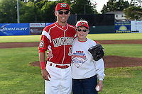Batavia Muckdogs Aaron Blanton (11) poses for a photo with Ann Gavenda  after she threw out the ceremonial first pitch before a game against the Auburn Doubledays on June 14, 2014 at Dwyer Stadium in Batavia, New York.  Batavia defeated Auburn 7-2.  (Mike Janes/Four Seam Images)