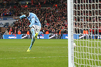Yaya Toure of Manchester City scores the winning penalty in a shoot out against Liverpool to win the Capital One Cup during the Capital One Cup match between Liverpool and Manchester City at Wembley Stadium, London, England on 28 February 2016. Photo by David Horn / PRiME Media Images.