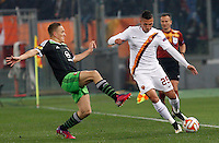 Calcio, andata dei sedicesimi di finale di Europa League: Roma vs Feyenoord. Roma, stadio Olimpico, 19 febbraio 2015.<br /> Roma's Jose' Holebas is challenged by Feyenoord's Jens Toornstra, left, during the Europa League round of 32 first leg football match between AS Roma and Feyenoord at Rome's Olympic stadium, 25 February 2015.<br /> UPDATE IMAGES PRESS/Riccardo De Luca