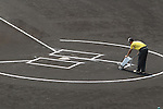 General view,<br /> AUGUST 25, 2014 - Baseball :<br /> A member of the grounds crew lines the batter's box before the 96th National High School Baseball Championship Tournament final game between Mie 3-4 Osaka Toin at Koshien Stadium in Hyogo, Japan. (Photo by Katsuro Okazawa/AFLO)