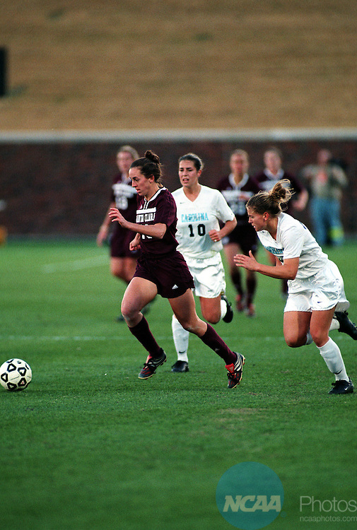 9 DEC 2001: Kristi Candau (19) of Santa Clara University races ahead of Sara Randolph (10) and Danielle Borgman (30) of the University of North Carolina-Chapel Hill during the NCAA Women's Division 1 Soccer Championships held at Gerald J. Ford Stadium on the campus of Southern Methodist University in Dallas, TX.  Santa Clara University defeated the University of Carolina-Chapel Hill 1-0 to win the national title.  Alison Woodworth/NCAA Photos