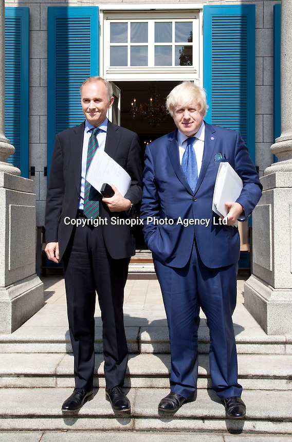 OCTOBER 15, 2015 -TOKYO, JAPAN:  London Mayor, Boris Johnson (right) at the British Embassy in Tokyo with British Ambassador,  Tim Hitchens. The was in Japan to encourage collaboration between London and Japan in financial technology.  (Photo / Ko Sasaki  )