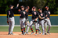 Mercer Bears players Travis Benn #3, Sasha LaGarde #8, Derrick Workman #11, Nate Moorhouse #2, and Evan Boyd (L-R) celebrate after a game against the Notre Dame Fighting Irish at Buck O'Neil Complex on February 17, 2013 in Sarasota, Florida.  Mercer defeated Notre Dame 5-4.  (Mike Janes/Four Seam Images)